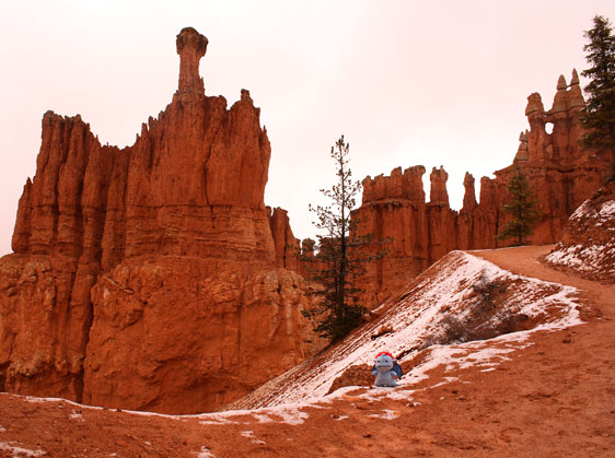 Standing with the hoodoos on a relatively dry segment of Peek-A-Boo Loop trail in Bryce Canyon