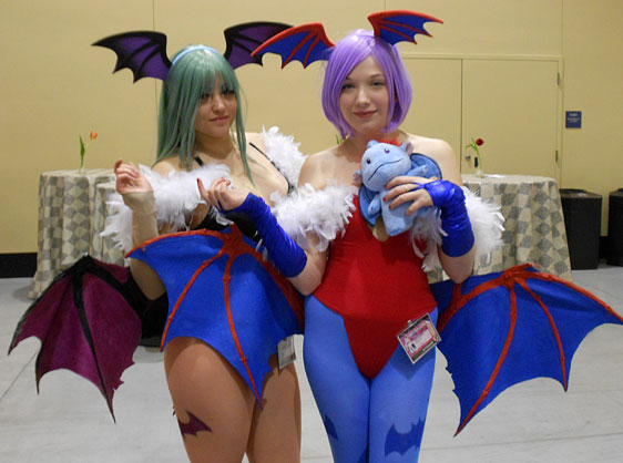 Darkstalker cosplayers Morrigan and Lilith save a sperel