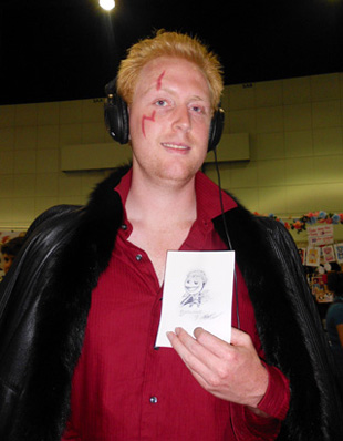 A Laxus cosplayer from the manga 'Fairy Tale' presenting his fan art.